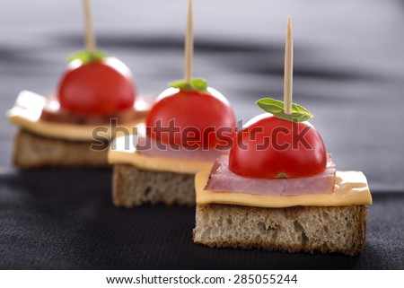 Close up of toast with cheese and ham - stock photo
