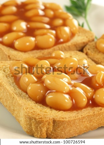 Close up of toasts with baked beans - stock photo