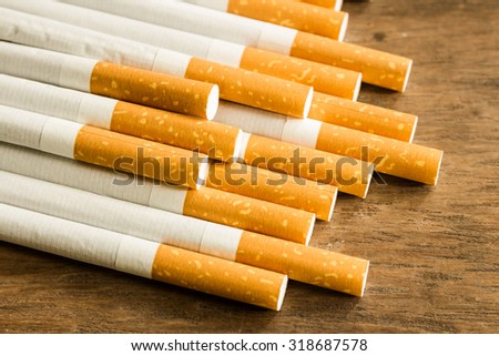 Close-up of Tobacco Cigarettes on wood,unhealthy - stock photo