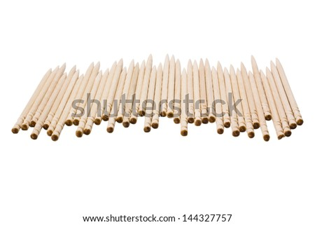 Close-up of toothpicks in a row