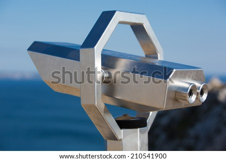 Close-up of Tourist Binoculars in Brittany, The Pointe de Pen Hir. - stock photo