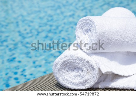 Close-up of towels at a luxury swimming pool