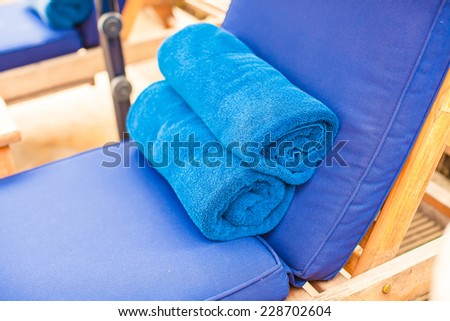 Close-up of towels near swimming pool at tropical resort - stock photo