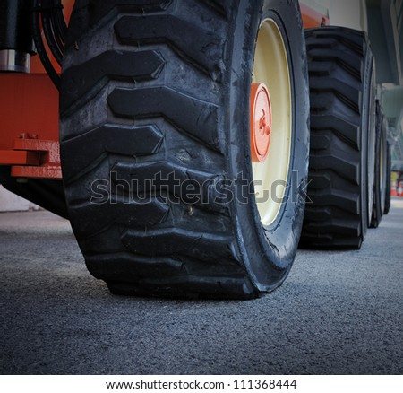 Close up of tractor tire, selective focus. - stock photo