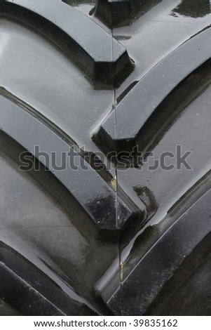 Close-up of tractor tire tread as background. - stock photo