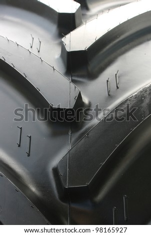 Close-up of tractor tire with rubber needles (very shallow DOF)