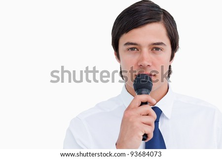 Close up of tradesman with microphone against a white background