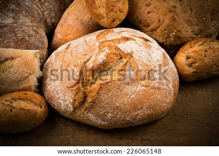 Close-up of traditional bread on a wooden table - stock photo