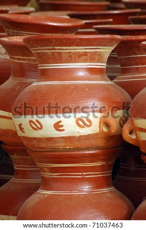 Close up of traditional clay pottery for sale in Mali