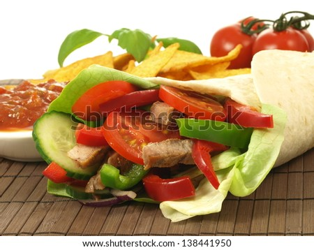 Close up of traditional mexican tortilla with nachos - stock photo