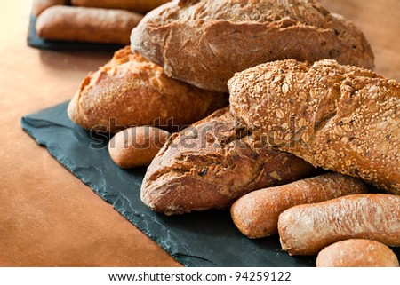 Close up of traditional whole wheat, cereal and brown bread. - stock photo