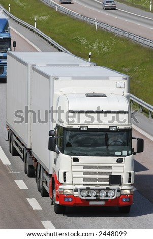 close-up of truck, lorry-cabin driving on highway - stock photo