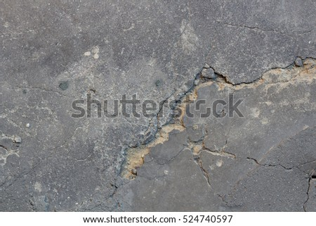 Close up of truly cracked concrete floor