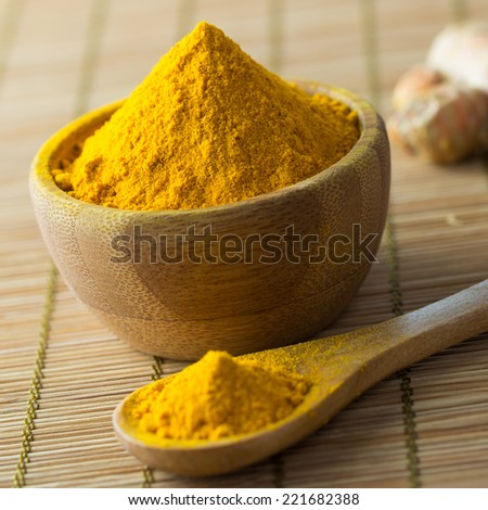 Close up of turmeric powder on bamboo mat - stock photo