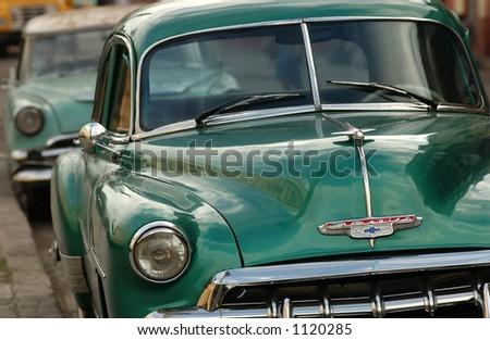 Close-up of two antique cars, Havana, Cuba - stock photo