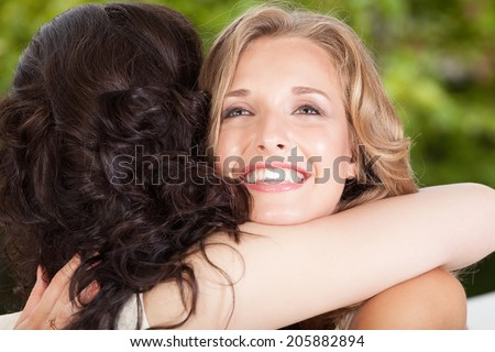 Close-up of two best friends hugging - stock photo