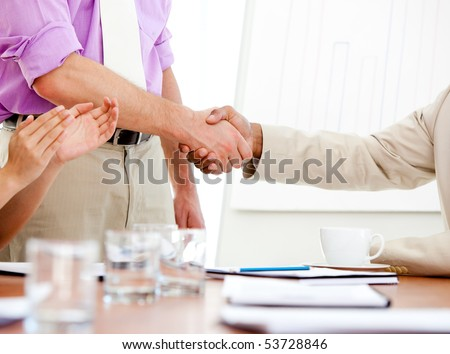 Close-up of two business partners closing a deal. Business concept. - stock photo