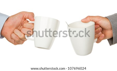 Close-up of two business partners hands holding cups of coffee - stock photo