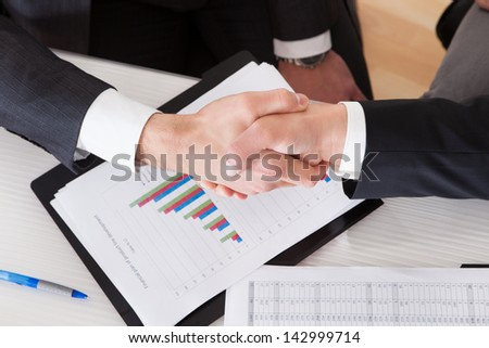 Close Up Of Two Business People Shaking Hands - stock photo