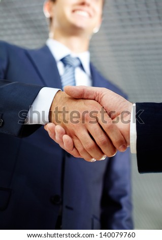 Close-up of two businessmen handshaking after making agreement - stock photo
