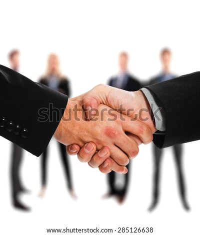 Close-up of two businessmen shaking hands