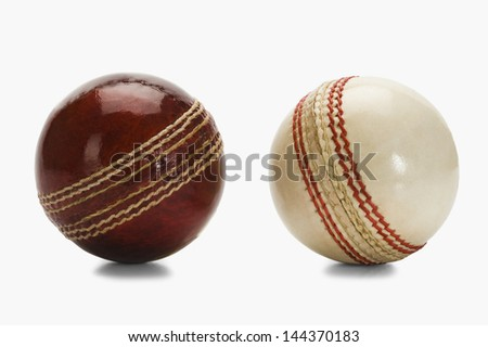 Close-up of two cricket balls