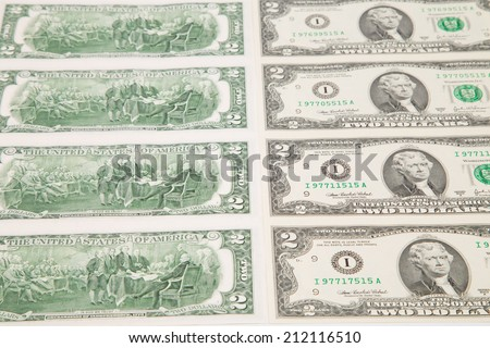 Close up of two-dollar bills. Whole background.