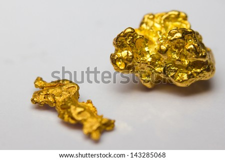 Close-up of two gold-nuggets - stock photo