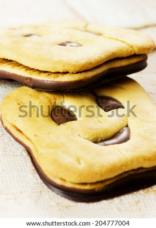 Close up of two happy face(Smiley) biscuits. - stock photo