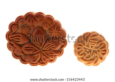 Close up of two mooncakes isolated on white background. (The chinese words indicates the type of mooncake, not the brand)