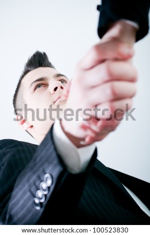close-up of two people hands shaking after signing contract - colorized photo - stock photo
