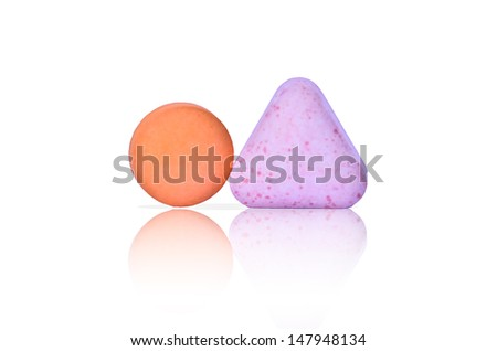 Close up of two pills - stock photo