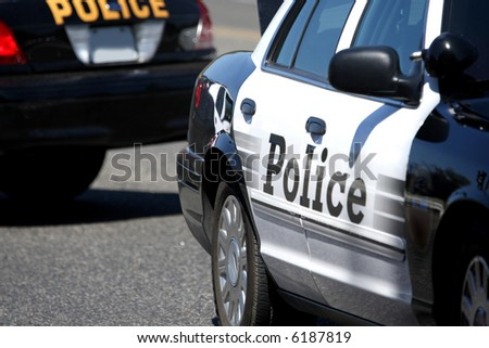 Close up of two police cars parked