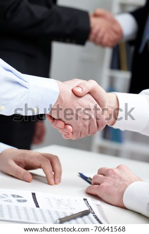Close-up of two shaking hands - stock photo
