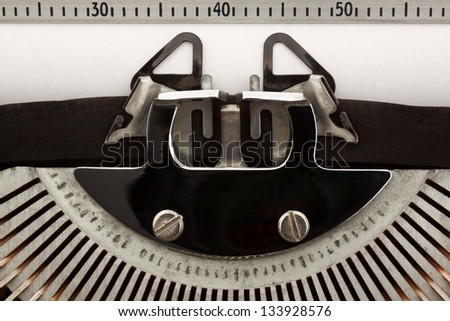 Close-up of typewriter with blank sheet of paper. Space for copy.