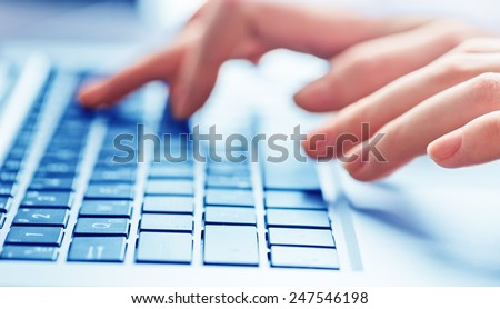 Close-up of typing female hands on keyboard - stock photo