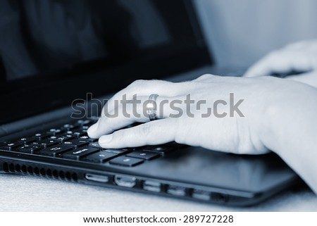 Close-up of typing female hands on keyboard.  Business woman hand typing on laptop keyboard. - stock photo