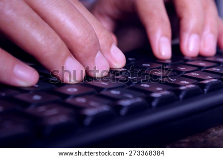Close-up of typing male hands - stock photo
