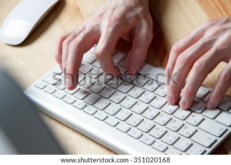 close up of typing man's hands