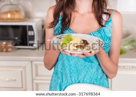 Close Up of Unidentifiable Brunette Woman Holding Plate of Pasta - Serving Home Cooked Meal for Dinner