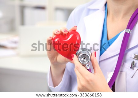 Close-up of unknown female doctor with stethoscope isolated