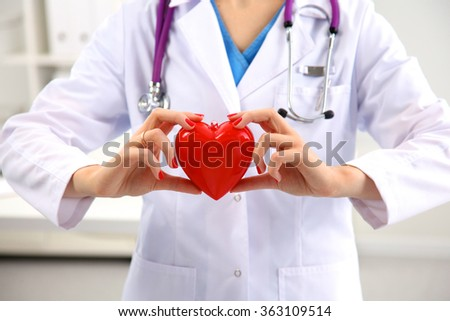Close-up of unknown female doctor with stethoscope isolated - stock photo