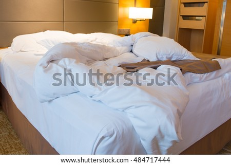 Close up of unmade bed in hotel bedroom