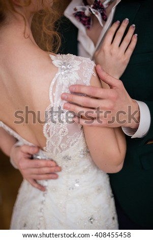 Close-up of unrecognizable couple of newlyweds hugging
