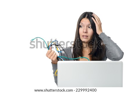 Close up of Upset Woman in Gray Long Sleeve Shirt holding Tangled Network Cables in Her Hand While Experiencing computer problems, Isolated on White Background. - stock photo