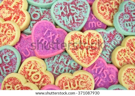 close up of valentine sugar cookies with love messages - stock photo