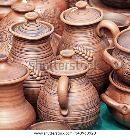close-up of various dishes from clay handmade in natural light - stock photo