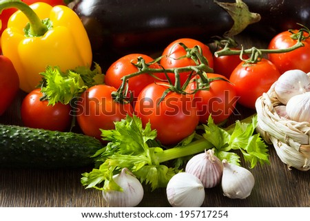 Close up of various vegetables on wooden cutting board - stock photo
