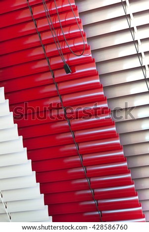 Close up of various Venetian blinds inside a house