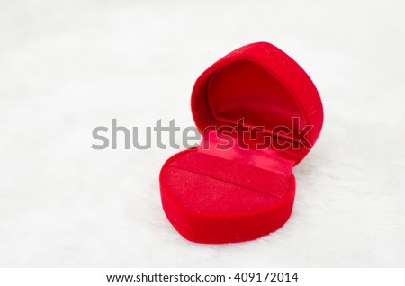 Close up of velvet red box on white carpet background, Valentine's day, love concept, marry me - stock photo